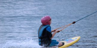 person holding on a rope for kneeboarding