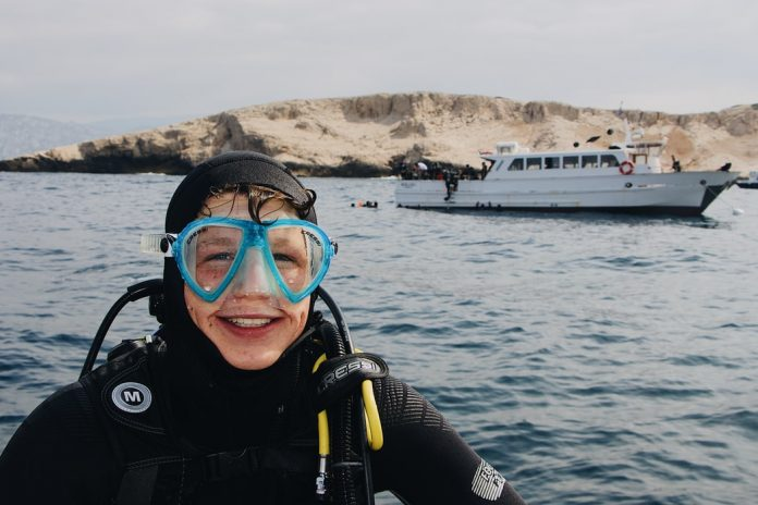 person wearing scuba during daytime