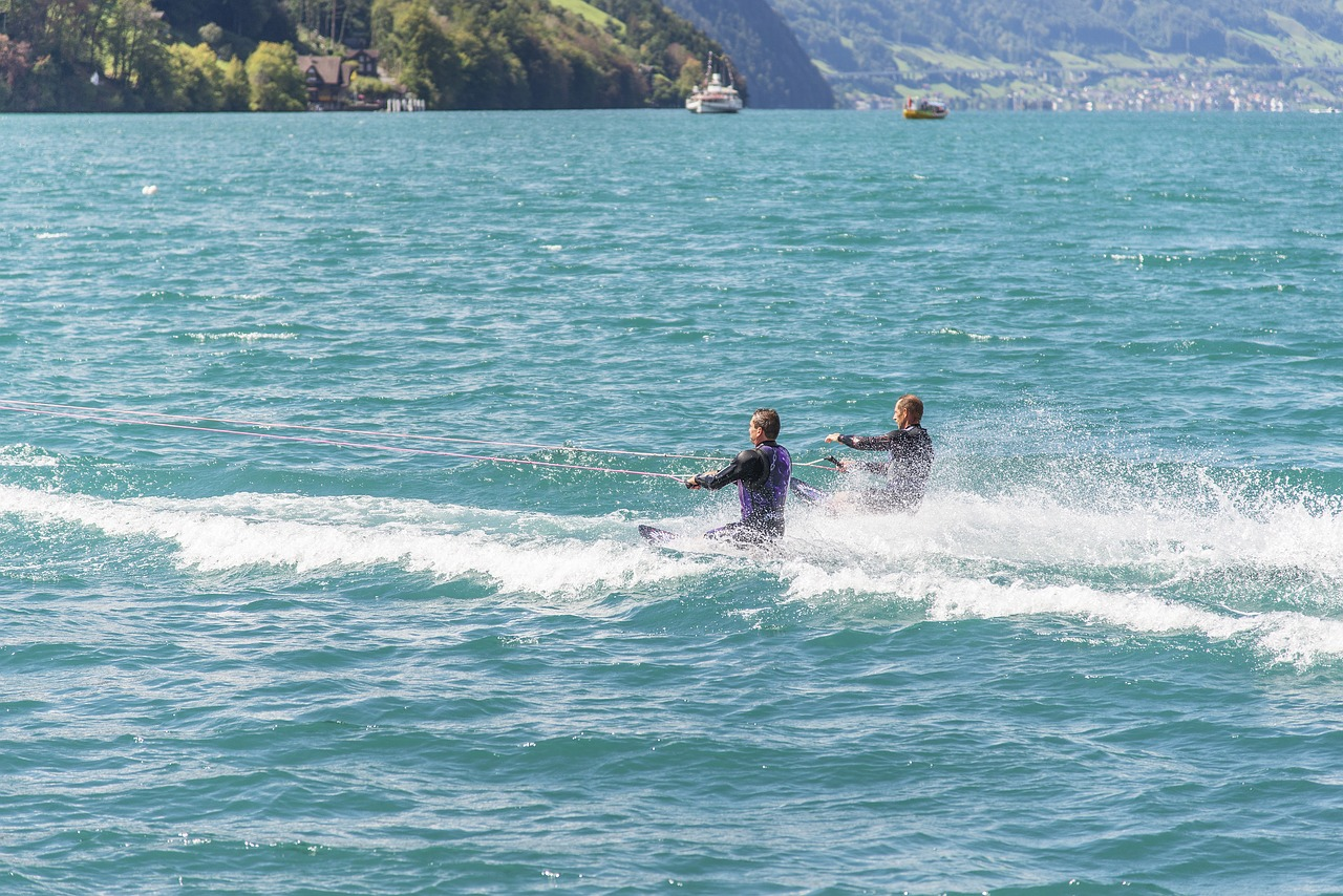 two person kneeboarding in a lake