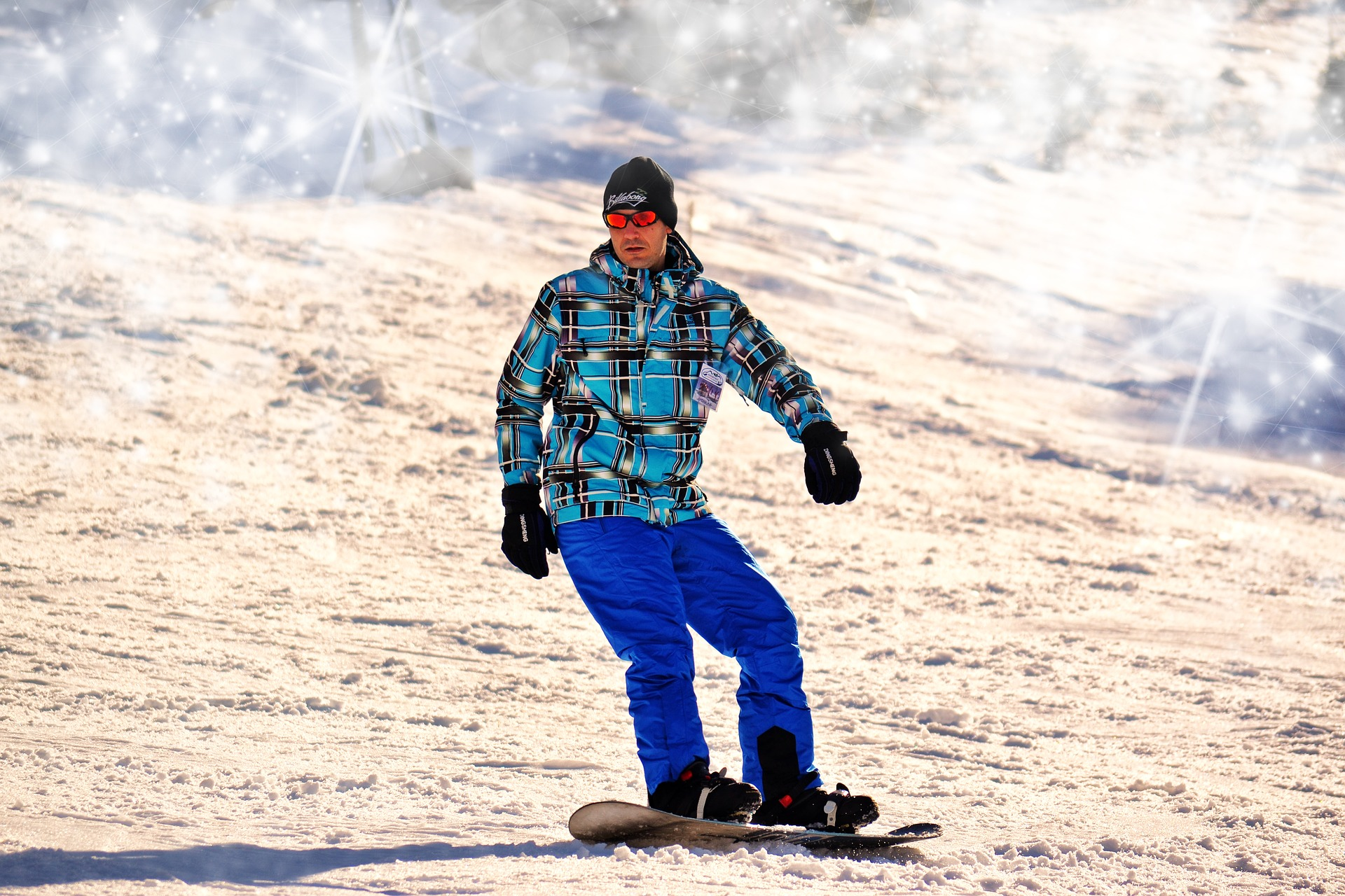 man snowboarding and wearing the best snowboarding boots